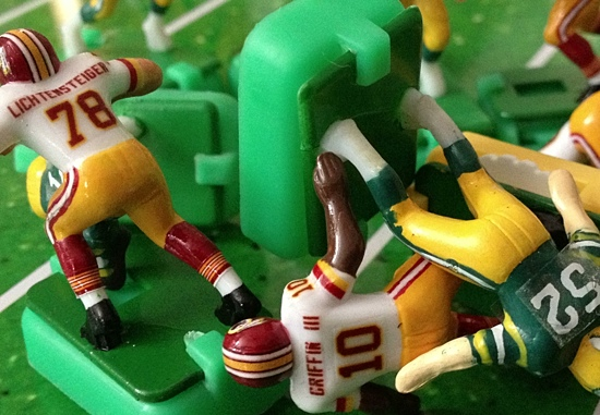 Robert Griffin getting hit by Linebacker Clay Mathews in the second quarter.
