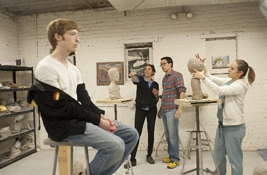 Plastic surgeons sculpt a bust with the help of sculptor Morgan Yacoe.