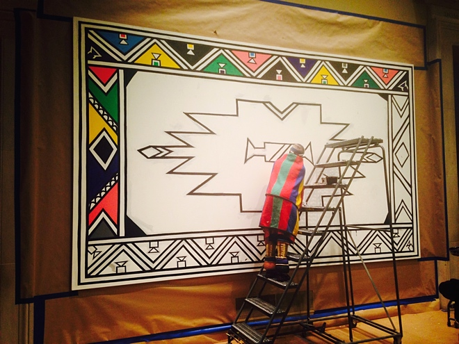 Mahlangu working on the first mural, now completed.
