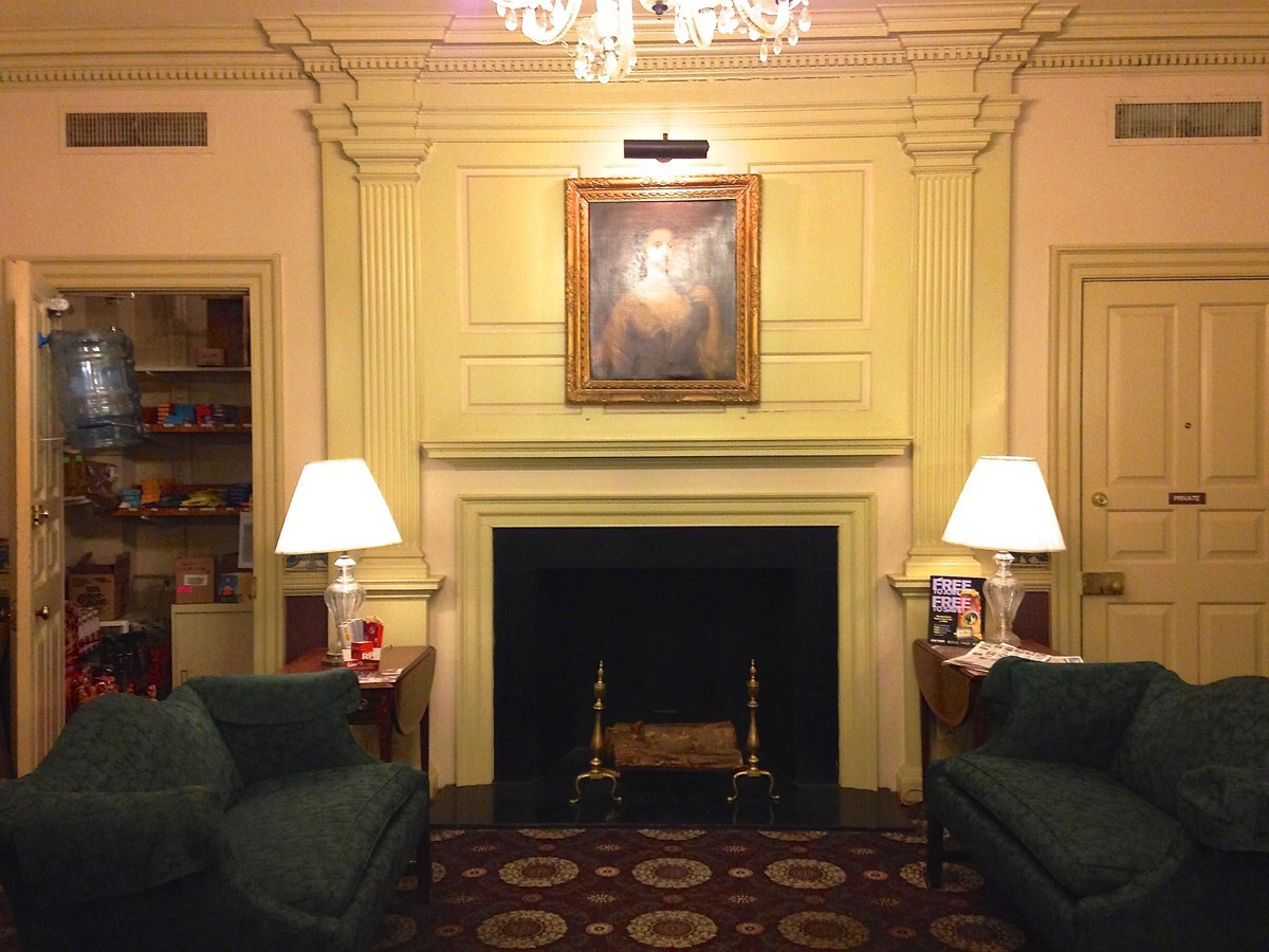 Lobby with sofas, mysterious portrait, and candy closet.