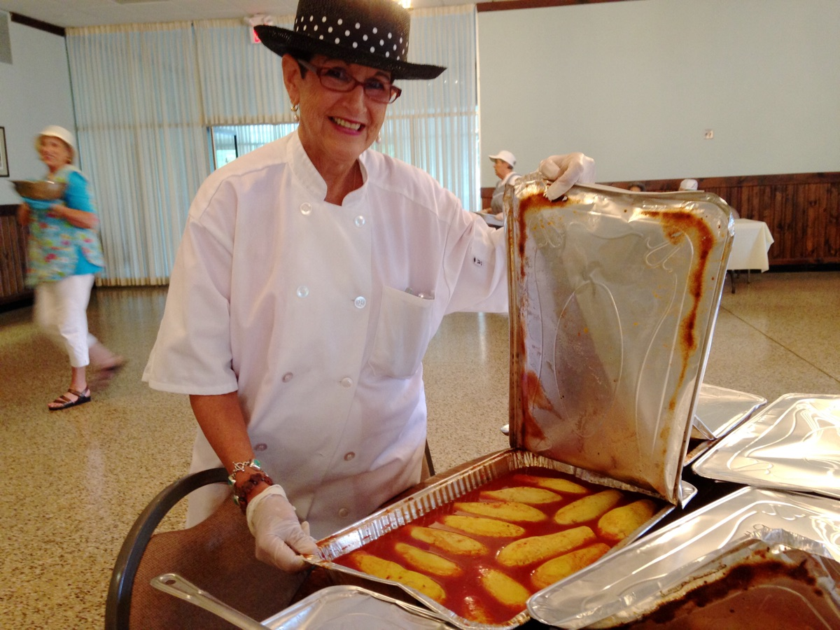 Sandra Joseph Brown, showing off the baked stuffed squash before they're cut and presented.