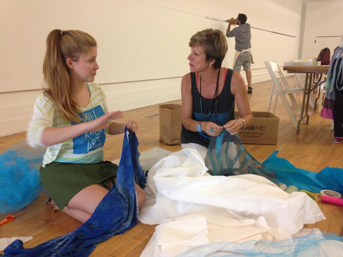 Abernathy Bland (left), a Milk River Arts mentor, and Sally Kemp preparing materials