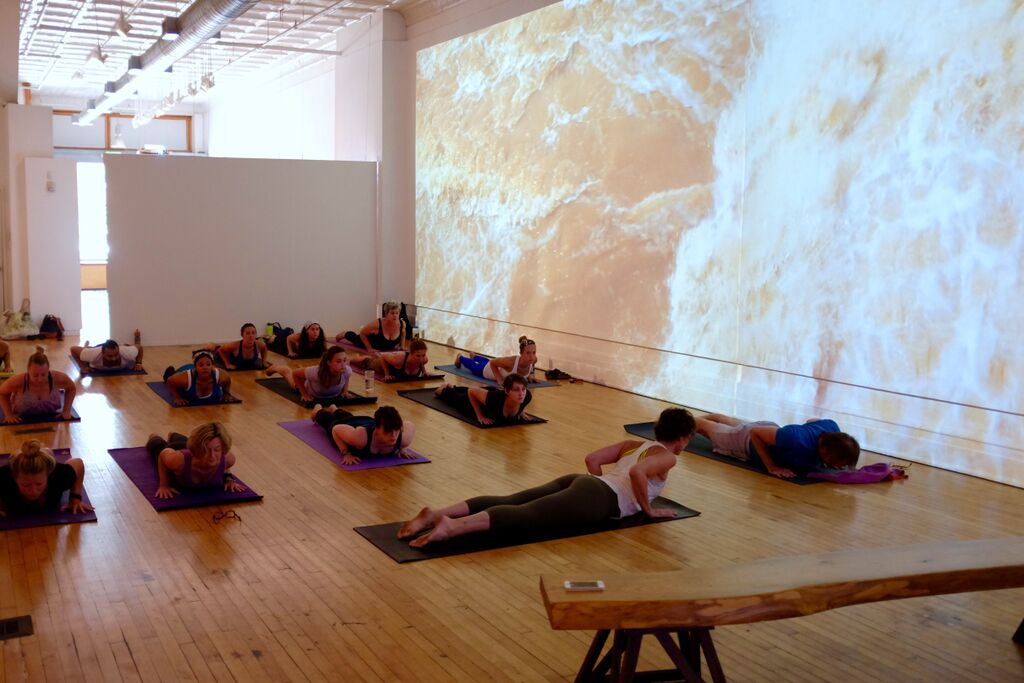 Caption: A yoga class courtesy of Karen Hansen from Ashtanga Yoga. It is very, very easy to zone out in peaceful bliss when facing that projection wall. Photo courtesy of Daniel White.
